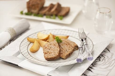 Meat loaf with tomato and  onion gravy